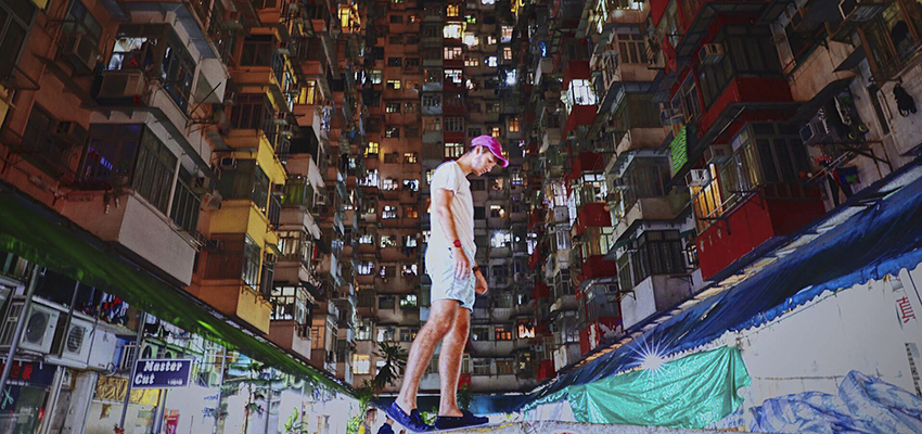 Jonah Salita '19 walks along a dividing wall in downtown Hong Kong where he is studying abroad.