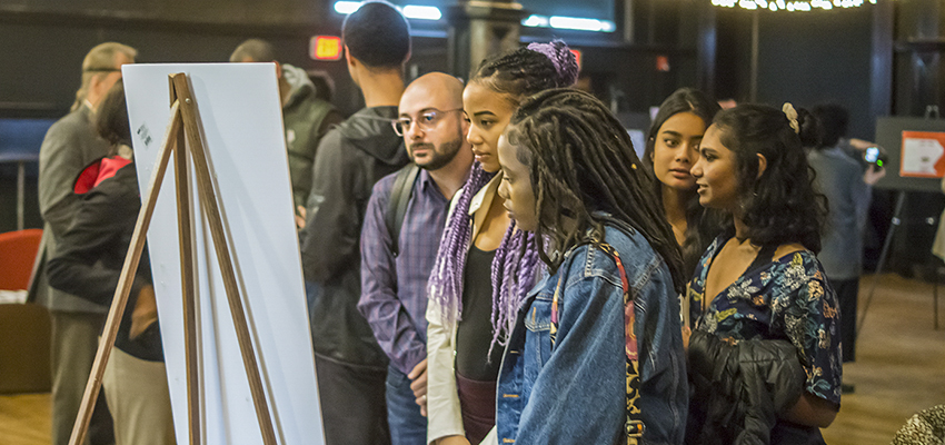 "Faculty, staff and students attend the ""Social Biology"" art exhibit by Jess Ramtahal '20, which explores the intersection of race and gender."