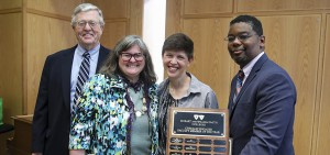Interim President Patrick A. McGuire L.H.D. '12 and Provost and Dean of Faculty DeWayne Lucas present Associate Professor of Education Mary Kelly and Professor of Dance Cadence Whittier with the Civically Engaged Faculty Member of the Year award at the Community Engaged Scholarship Forum.