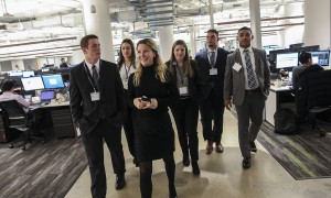 Equity Data and Analytics Sales Specialist at IHS Markit Paige Pierce '17 leads a tour of IHS Markit. Facilitated by Career Services, more than 20 students arrived in Manhattan to connect with alums, parents and friends of the Colleges who work in the financial services industry.