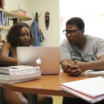 Yalemwork Teferra '20 and Assistant Professor of Economics Keoka Grayson meet discuss summer research.