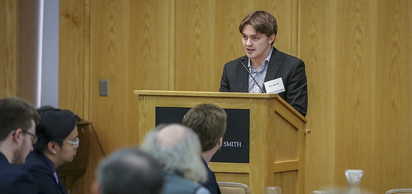 """Jonas Toupal '19, a geoscience major, addresses the Board of Trustees luncheon. Toupal discussed his honors project, """"Using Remote Sensing to Analyze Mercury Contamination in Vegetated Areas: The Case of Tarkwa, Ghana."""""""