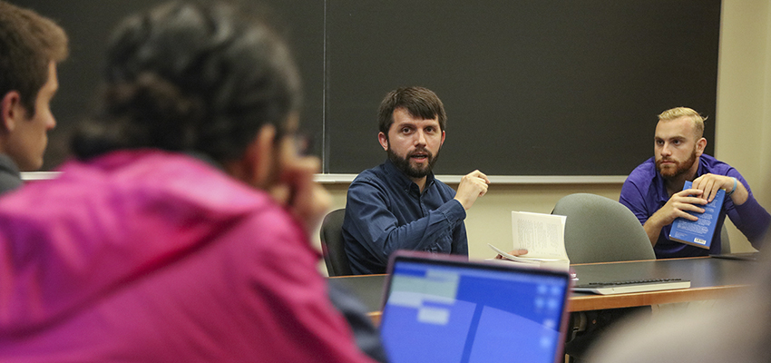"""Assistant Professor of English Alex Black teaches during """"Performing America."""""""