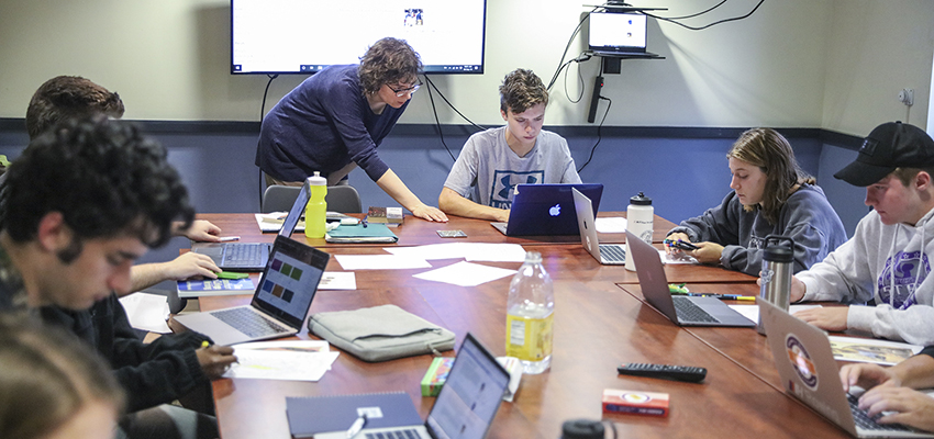 Associate Professor of Russian Area Studies assists students in her First-Year Seminar.