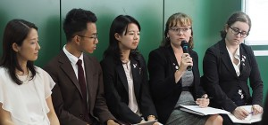 Carly Shiever (second right) speaks during the conference