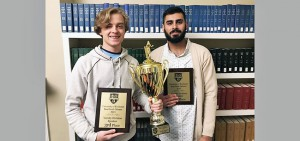 Bart Lahiff '20 and Sarim Karim '22 hold trophy and individual honors after Brad Smith IV debate.