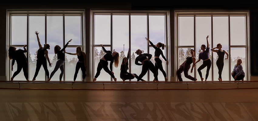 Students who were slated to perform in the Junior/Senior Choreographers' showcase pose for a publicity poster in the Gearan Center for the Performing Arts.