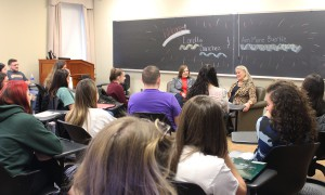 """Former Congressional representatives Loretta Sanchez (D-CA) and Ann Marie Buerkle (R-NY) speak with students in """"Juvenile Delinquency"""" taught by Associate Professor of Sociology Jim Sutton. Their visit was part of the Congress to Campus initiative."""