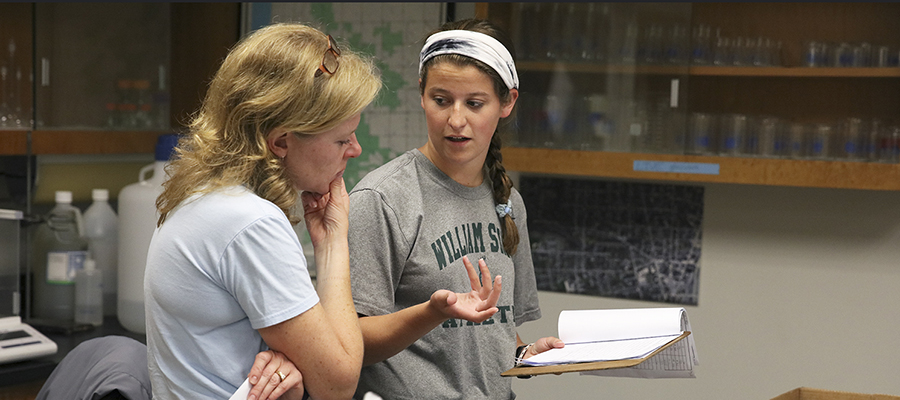Director of Introductory Biology Laboratories Susan Flanders Cushman '98 (left) and Kate Foley '20 discuss Foley's summer research.