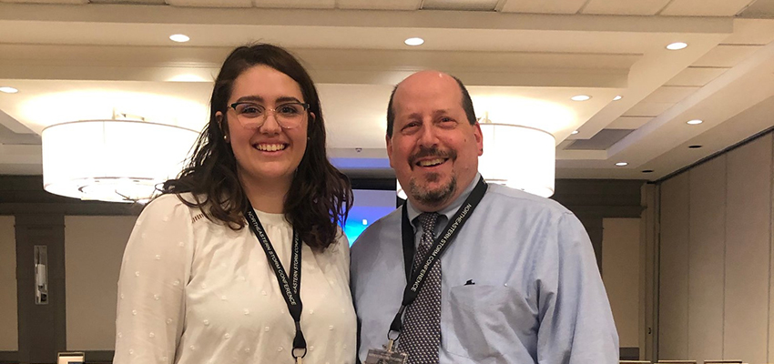 At the Northeast Storm Conference, Linscott poses with her research mentor Plymouth State University Professor Eric Hoffman.