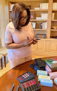 Yohannes keeps this photo of Oprah looking at 2.4.1. lip gloss in her office. Image courtesy of Oprah.com.
