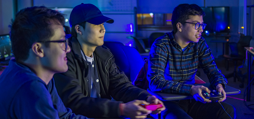 Phillip Hsieh '22, Jae Kim '21, and William Persina '22 play Super Mario Smash Bros. at the After Dark Gaming Night organized by the E-Scape club and Residential Education.