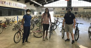 Raja Mehmood '22 (left) assists with the Connect Geneva Bike Collection and Distribution Project which helped connect donated bikes with local youth.
