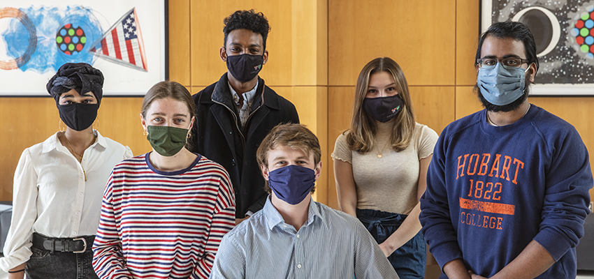 """All of the student trustees gather in the Gearan Center for the Performing Arts. From left to right, Audrey Platt '21, Zaheer Bowen '23, Thomas """"Gib"""" Shea '22, Irini Konstantinou '23, Albright Dwarka '21 and Nuzhat Wahid '22."""