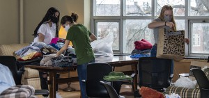 Students organize clothing in Hirshson Ballroom for donation to local non-profits in Geneva.